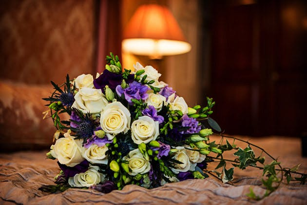 Beautiful Bridal Bouquet with Purple and Ivory