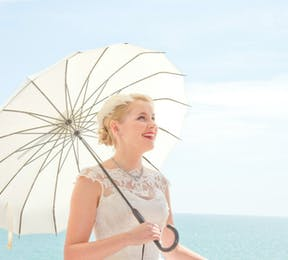 Bride with parasol by Fabulous Wedding Photography