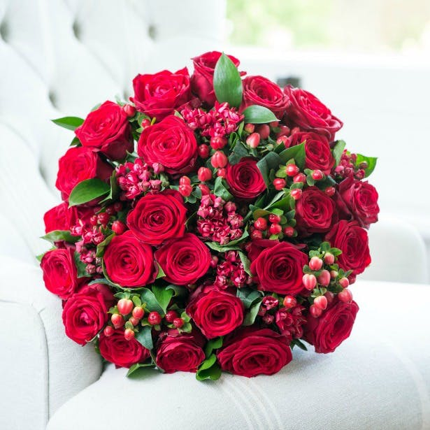 Red winter bouquet by Drake Florists | Confetti.co.uk