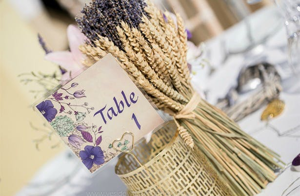 Lavender table decorations at Marina and Gary's lavender themed Real Wedding | Confetti.co.uk