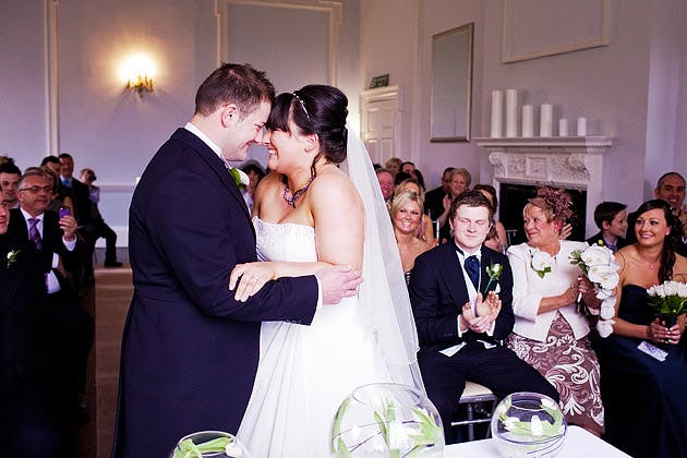 bride and groom laugh during ceremony