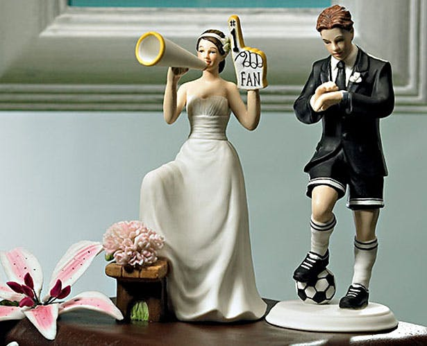 Cake topper with sporting bride and groom