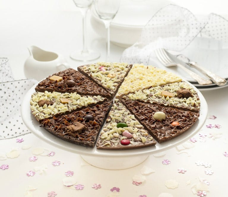 Delicious Dilemma Chocolate Table Centrepiece - Chocolate Pizza Slices from The Gourmet Chocolate Pizza Co - Chocolate Pizza for Weddings - Wedding Dessert Ideas - Interesting Wedding Favours - Chocolate Wedding Favours | Confetti.co.uk