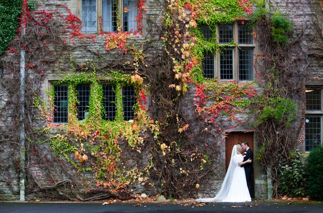 Bride and Groom outside the ivy wrapped Armathwaite Hall