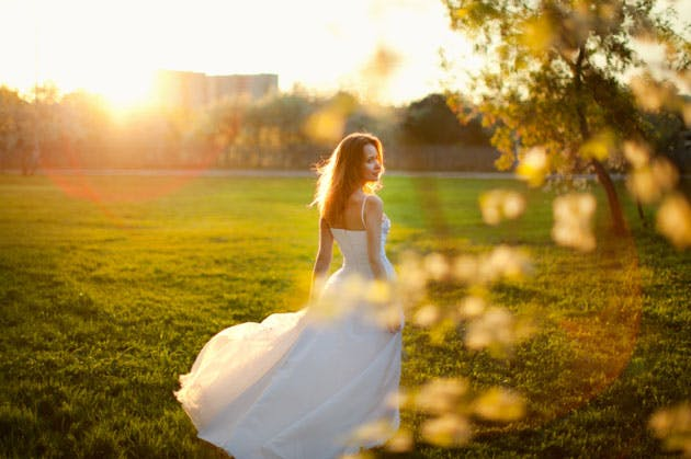 Summer wedding, a beautiful bride in the the sunset