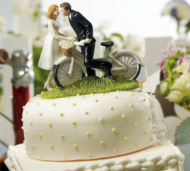 Bride and groom bicycle cake topper | Confetti.co.uk