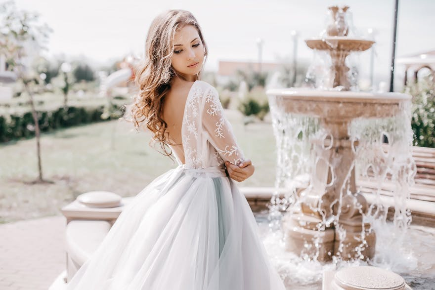 Beautiful Bride By A Fountain Princess Wedding Dresses From Shutterstock Confetti Co