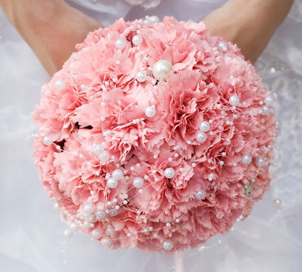 A pomander bouquet in pink and white