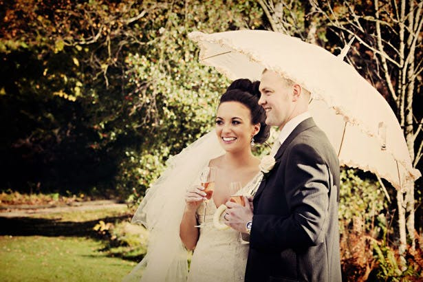 Newlyweds with parasol