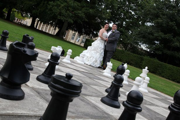Bride and groom with giant chess set