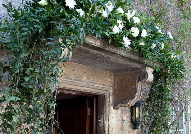 Bride's Hotel White Flowers on the Carved Stone Doorway Arch