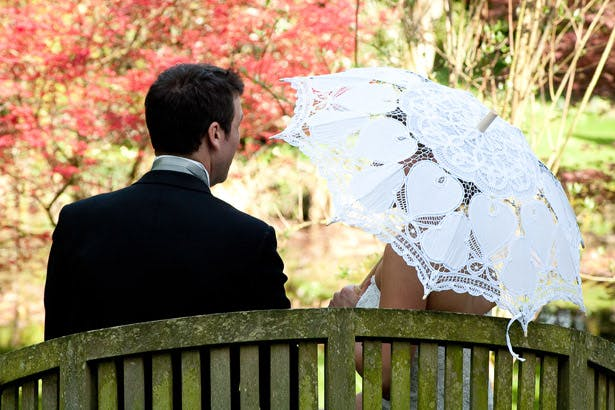 Bride And Groom On Garden Bench