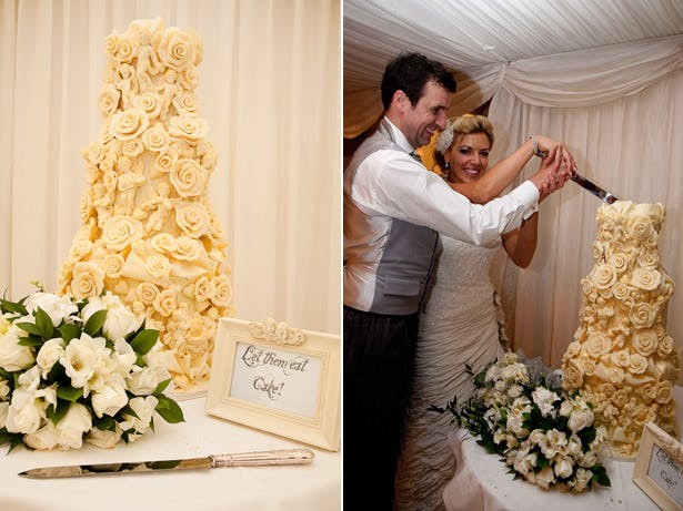 Bride And Groom Cutting Ivory Rose Wedding Cake