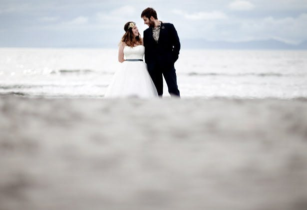 The bride and groom on a beach