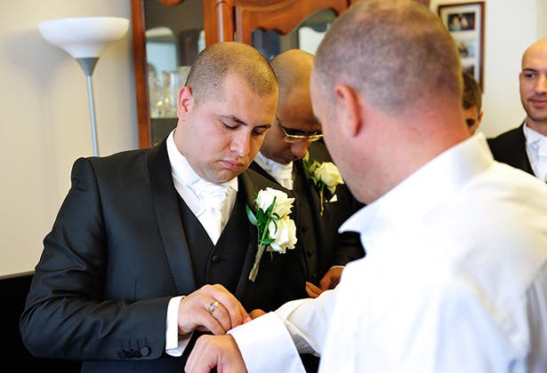 Grooms taking part in Greek wedding traditions 2
