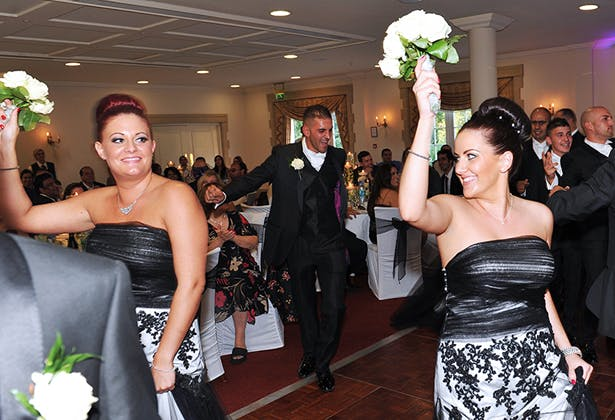 Bridesmaids in black strapless dresses