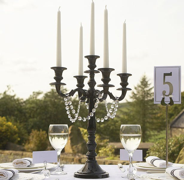 Black candelabra wedding table decoration | Confetti.co.uk