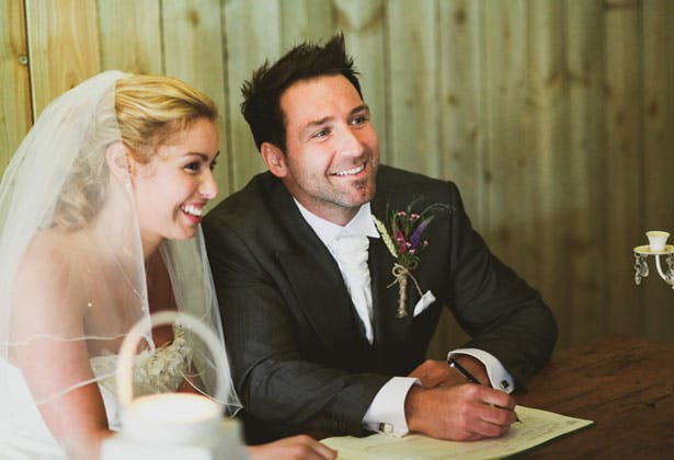 Bride and Groom signing