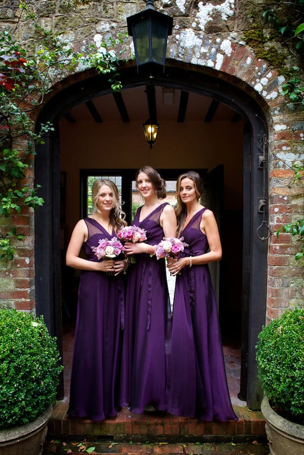 Bridesmaids in long purple gowns from Debenhams