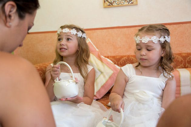 Flower girls in white dresses and floral head bands