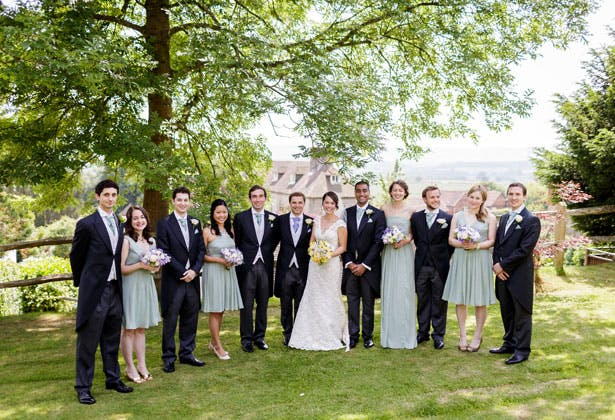 The newlyweds with their bridesmaids and groomsmen  by Douglas Fry Photography