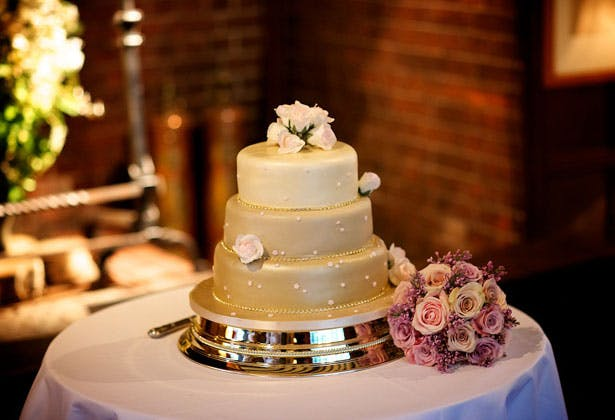 Champagne coloured wedding cake with rose details