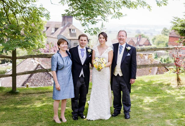 The newlyweds with the groom's parents by Douglas Fry Photography