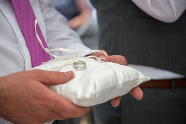 The wedding rings on a ring cushion
