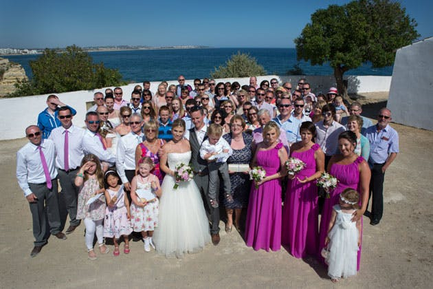 The newlyweds with their family and friends
