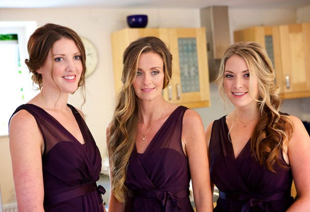 Bridesmaids in dark purple dresses
