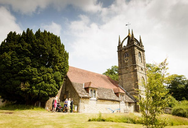 Wedding ceremony at All Hallows Church, Tillington, West Sussex