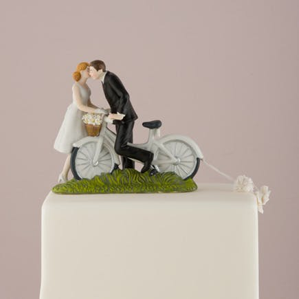 """""""A Kiss Above"""" Bicycle Bride and Groom Couple Figurine - Pretty Bicycle Wedding Cake Topper   Confetti.co.uk"""