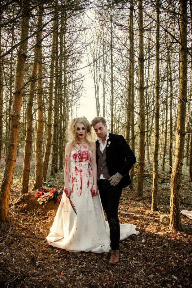 Blood stained zombie bride and groom in the woods by Halo and Hobby | Confetti.co.uk