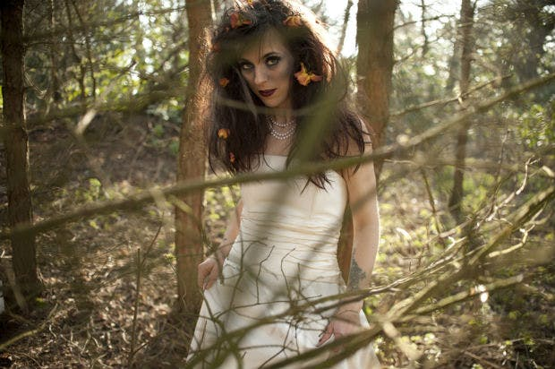 Zombie bride in the woods with flowers in her hair by Halo and Hobby