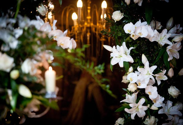 White indoor flower arrangement with candles