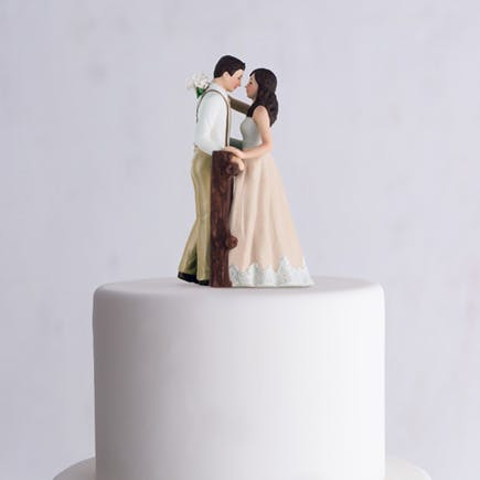 Rustic Couple by a Fence Porcelain Figurine Wedding Cake Topper - Rustic Wedding Cakes   Confetti.co.uk