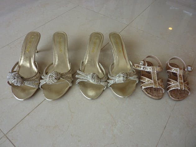 The bridesmaids and the flower girls gold sandals