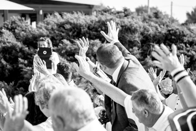 Guests waving to the photographer