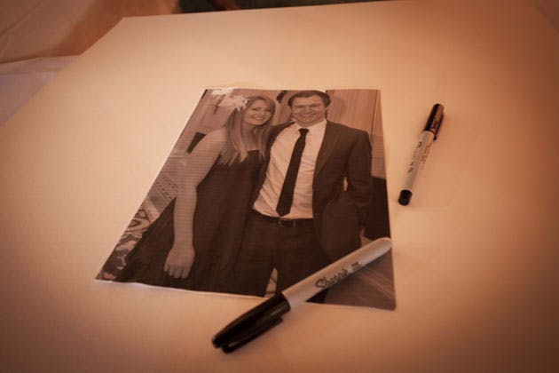 Signing book with the happy couples picture