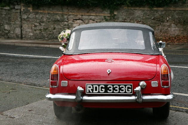 Vintage red MG wedding car