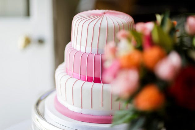 Pink and white wedding cake by Palette Events