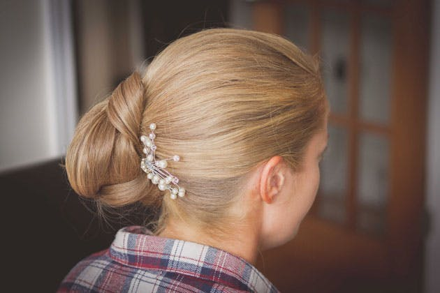 Bridal side hair do with pearl hair piece
