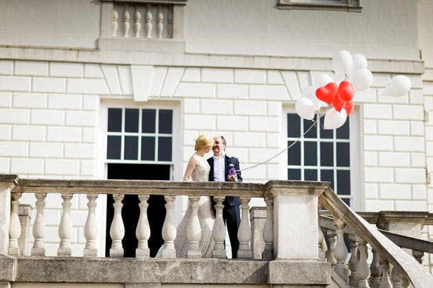 The bride and groom with heart shaped balloons