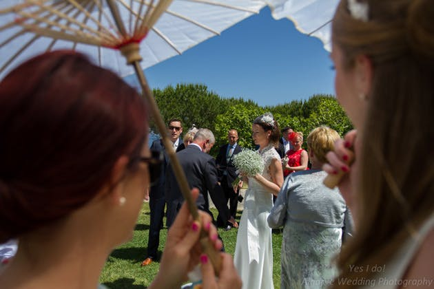 Wedding guest with a parasol