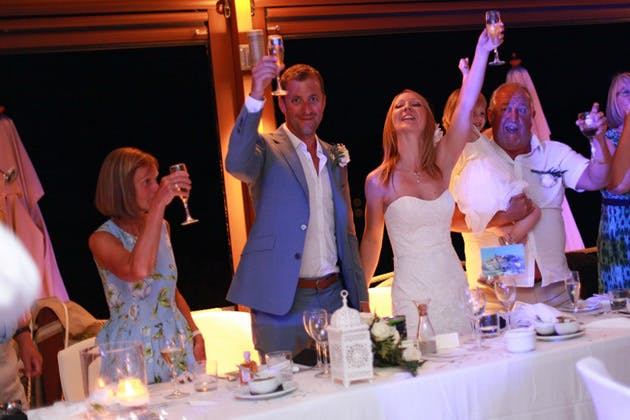 The wedding guests and the newlyweds toasting their marriage