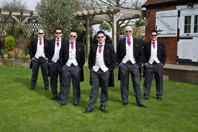 The groom with his best men in suits from Moss bros