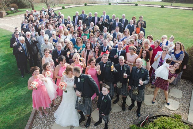 Group shot of the newlyweds with their guests