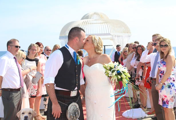 The newlyweds kissing