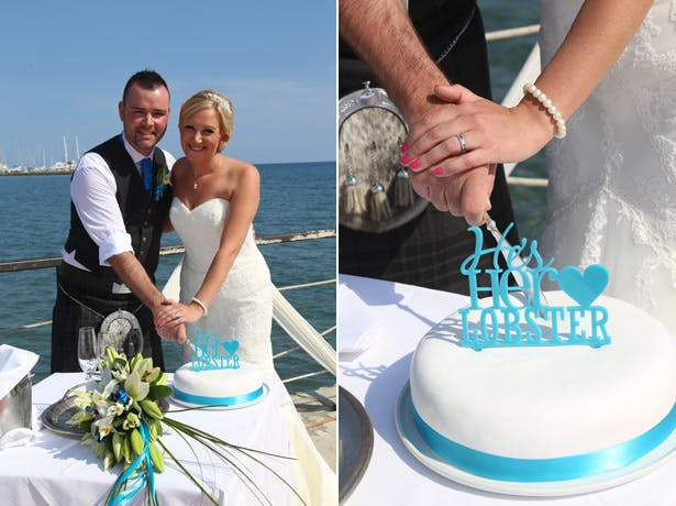 The happy couple cutting their wedding cake