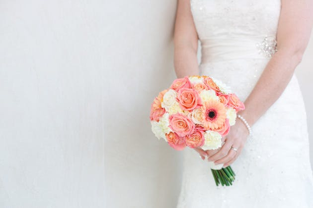 Ivory and coral fresh flower bridal bouquet